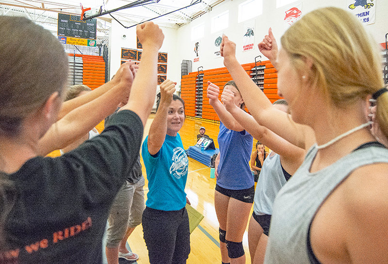PHS volleyball coach Lesli Spencer motivates her team before its matchup against Powell Valley Healthcare employees Monday. The 'Can U Dig It' scrimmage raised $700 for the Powell Athletic Roundtable.
