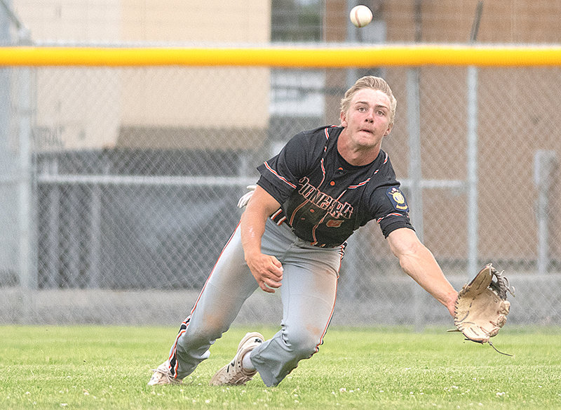 Outfielder Kobe Ostermiller dives for a ball in the Powell Pioneers' doubleheader against Cody on July 2. Powell enters this week's state tournament as the No. 3 seed from the West District.