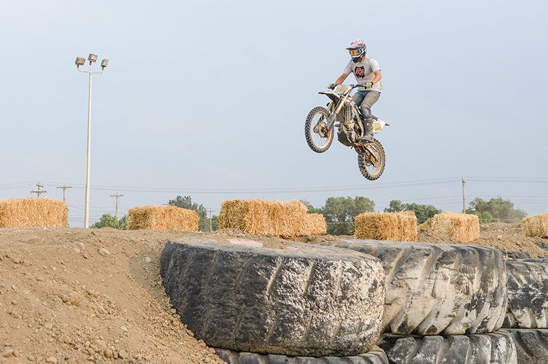 Josh Ashcraft takes to the air on the motocross track he and his friend, Talan Hooper, designed and built.
