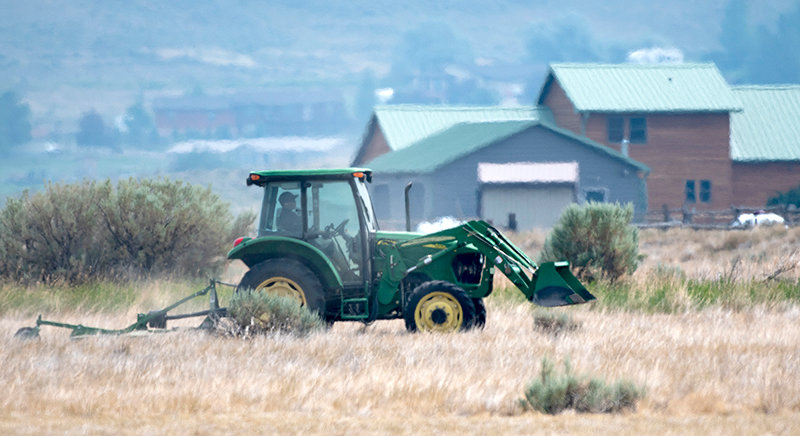 A crew member at Buffalo Bill State Park mows the grass in an area under consideration for an RV camping area on the South Fork side of the reservoir. Work has been halted on pending a public meeting set for August 9.