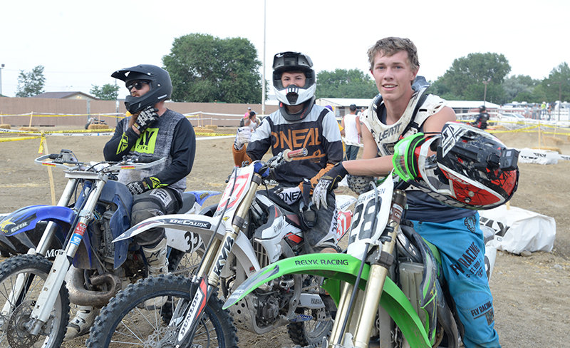 Randall Dilworth, Ethan Lee and Kyler Warren take a photo before racing in the 250 B class at the Park County Fair motocross. The event raised roughly $10,000 for Warren's mother, Stephanie, who is battling breast cancer.