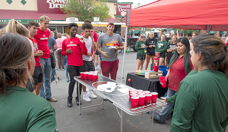 Williston State College volleyball team members challenge members of the Northwest College basketball team to a friendly game at Friday evening's Paint the Town Red event. The fourth annual celebration, intended to strengthen the relationship between NWC and the Powell community, also marked the 75th anniversary of the college.