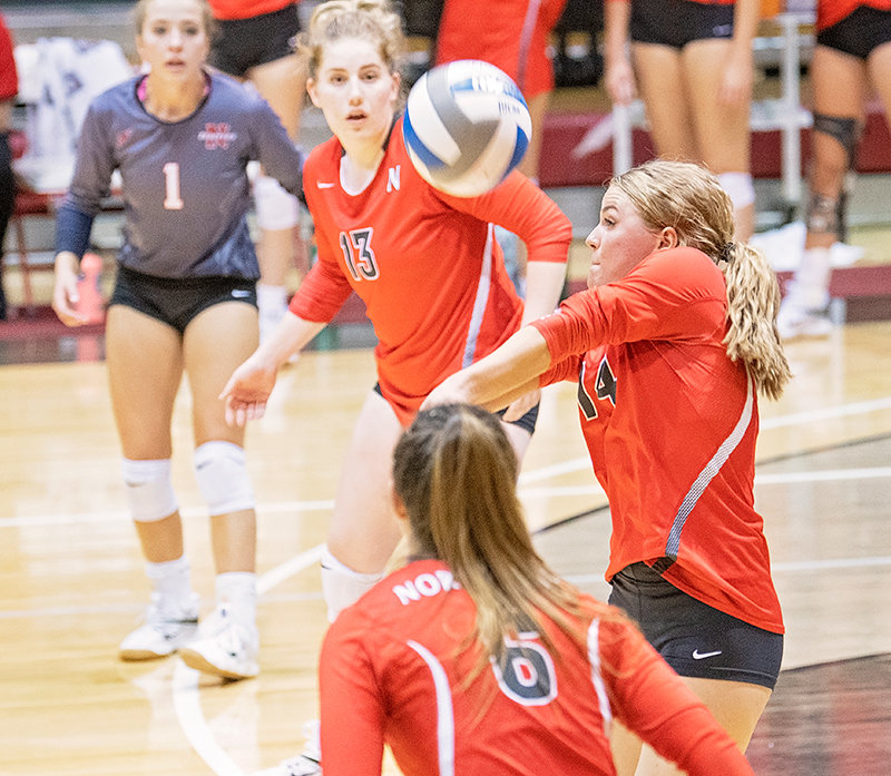 Cowley native Aubrianne Crosby records a dig for the Trappers in Friday's matchup against Colorado Northwestern Community College. From left, Paige Weimer, Karli Steiner and Brooke Palmer stand by ready to assist. The Trappers won the match in three sets, 27-25, 25-16, 25-21.