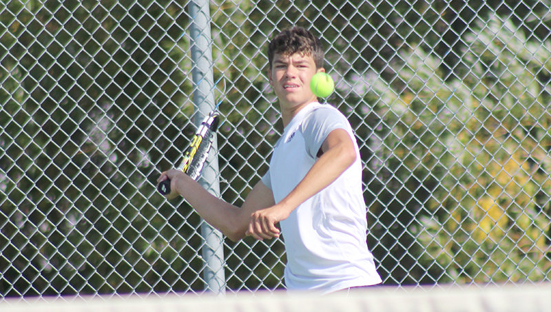 Ethan Bartholomew returns a forehand shot during the regional tournament in Sheridan last weekend. Bartholomew would go on to place fourth in the tournament, losing in the consolation championship.