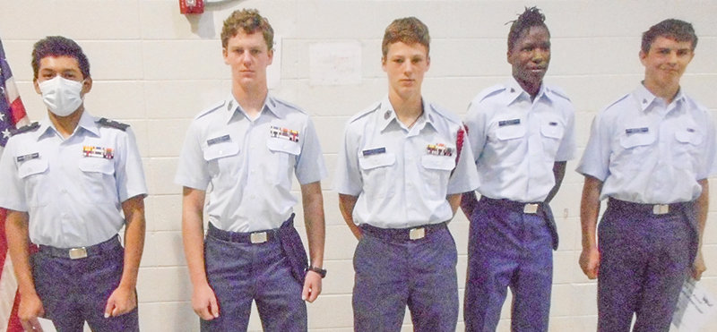 Five members of the Civil Air Patrol's Yellowstone Composite Squadron — from left, 1st Lt Rui Parker, CMSgt Jay Swaney, CMSgt Eli Swaney, Amn Adam Swaney and Amn Wyatt Houchin — earned recent promotions.