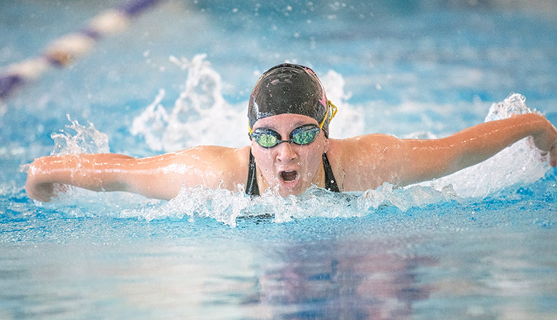 Kik Hayano swims in the 100 butterfly in the Cody Dual Tuesday afternoon. Hayano placed first in the event with a PR time of 1:10.77 and went on to place third in the 500 free before anchoring the 200 free relay.