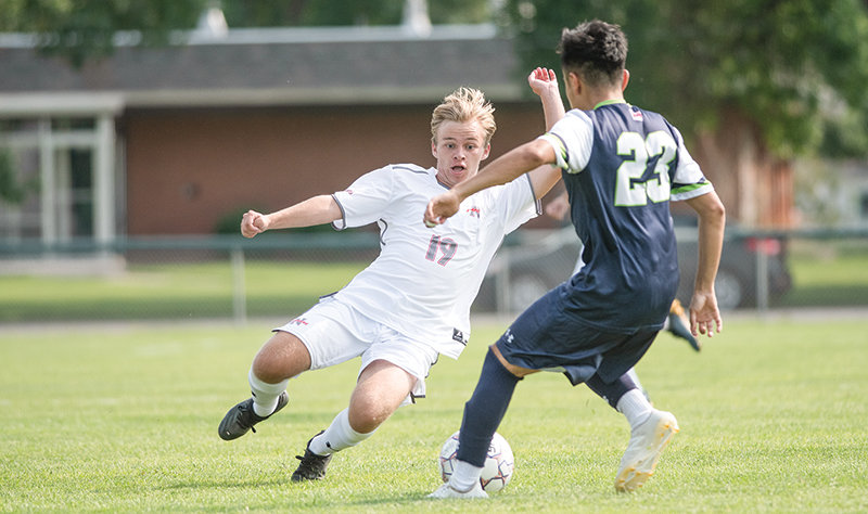 NWC freshman forward Landon Carpenter goes in for a slide tackle during a scrimmage against the University of Providence in August. The Trappers will return for their first home matches in over a month on Friday and Saturday.