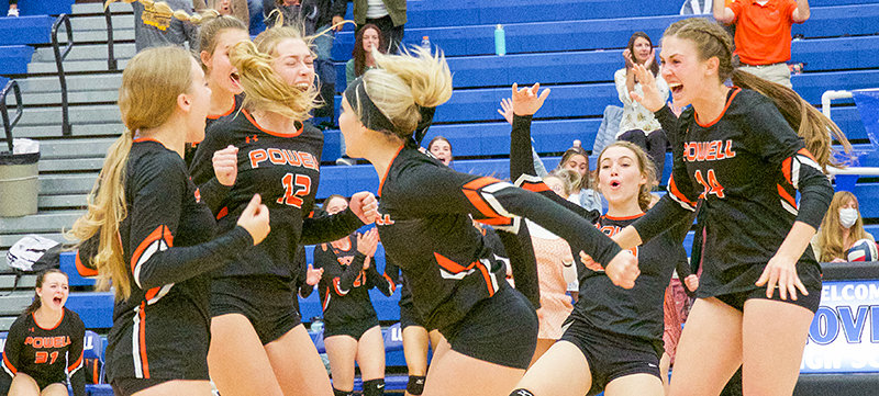 Gretel Opps, Kenzie Ratcliff (behind), Addy Thorington, Ashlyn Shorb, Maddie Campbell and Megan Jacobsen celebrate after rallying in the fifth set to defeat Lovell on the road.