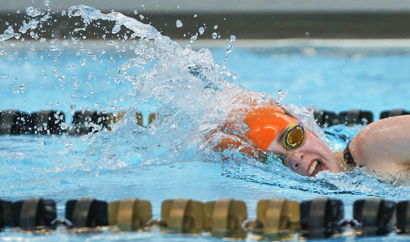 Powell High School's Sydney Legler takes a breath during the second half of her 200-yard freestyle race on Saturday morning at the YMCA in Buffalo. Powell was one of six schools to swim at the Buffalo invitational.