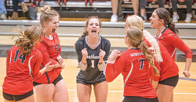 Aubrianne Crosby, Karli Steiner, Paige Weimer, Jacie Walker, Sidney Parker and Baylee Peterson come together in celebration after winning a point against LCCC on Friday. The Trappers would sweep the Golden Eagles, splitting the series season at a match a piece.