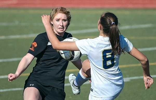 Lady Panther Mariah Phister (left) battles Cody's Alexa Prosceno for the ball Tuesday at Cody High School. Powell lost to the Fillies in a 2-1 overtime thriller.