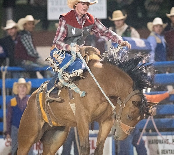 Trapper sophomore Caleb McMillan holds on for 8 seconds during the Trapper home rodeo in Cody last fall. McMillan won all-around in the first rodeo in Bozeman, Montana, last week and was runner-up in the second rodeo.