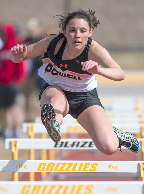 Lady Panther Sabrina Shoopman competes in the 100 meter hurdles Saturday at the Rocky Mountain Invite in Cowley. Results of Saturday's meet will be in Thursday's Tribune. Tribune photo by Mark Davis