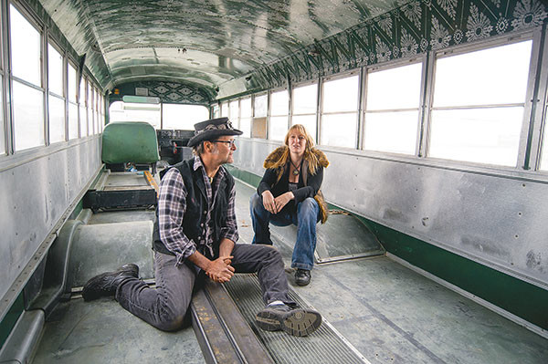 Todd Evans and April Jones have begun painting the interior of their bus, which they plan to turn into an 'art car.' Tribune photo by Mark Davis