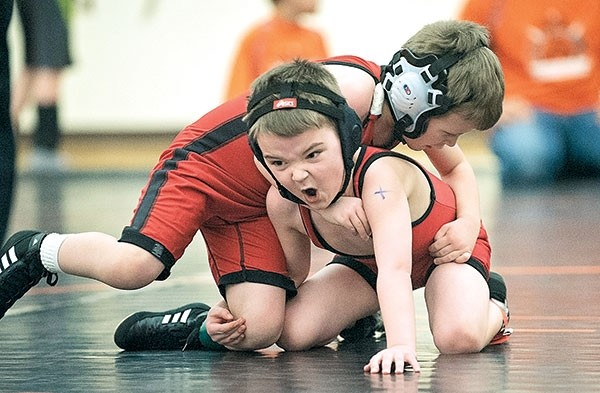 Kendall Matthews (bottom) works to free himself from Buskin Study during the Powell Wrestling Club's 3-Style Tournament in Powell last month.