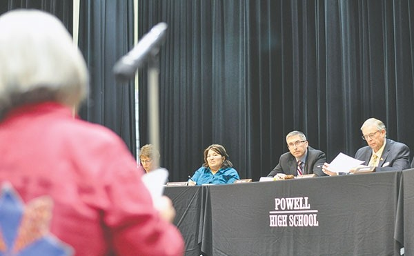 Park County School District No. 1 trustees (from left) Kimberly Condie, Lillian Brazelton, Trace Paul and Greg Borcher listen as Sharon Bailey shares her concerns about arming school staff. Trustees heard from 23 people during Monday's forum at Powell High School.