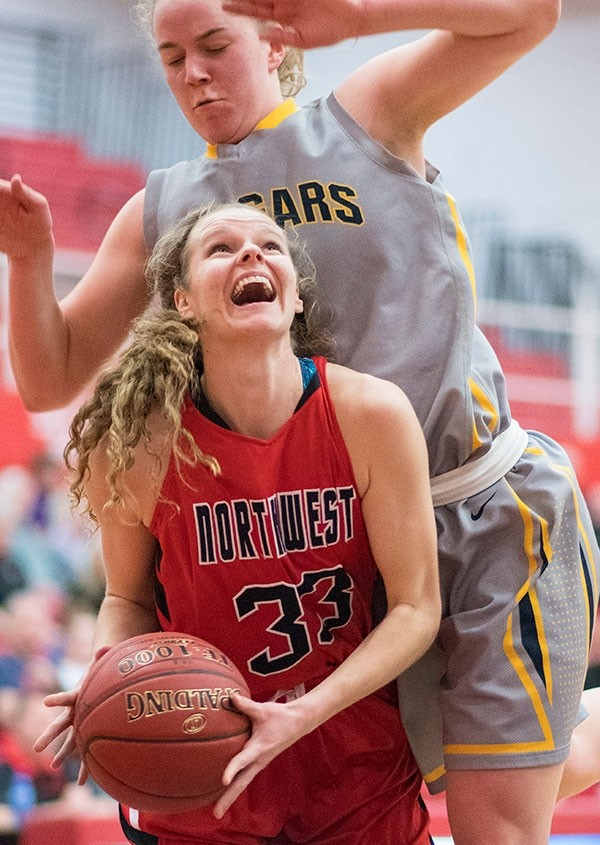 Northwest College sophomore Dani McManamen ducks under a Western Nebraska player Friday night in the Region IX Tournament semifinal game at Casper College. A late comeback bid by the Lady Trappers came up short in a 67-62 loss to end the season.