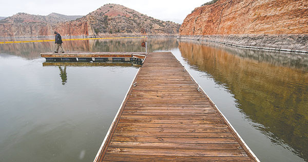 Thomas Darnell, a Bighorn Canyon National Recreation Area visitor, takes a stroll at the Barry's Landing boat docks to take in the views of the national park property.