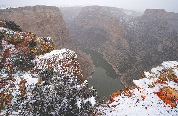 A fresh dusting of snow covers the ledges at Devil Canyon Overlook. The canyon is the third-deepest canyon in the U.S., over 1,000-feet deep.