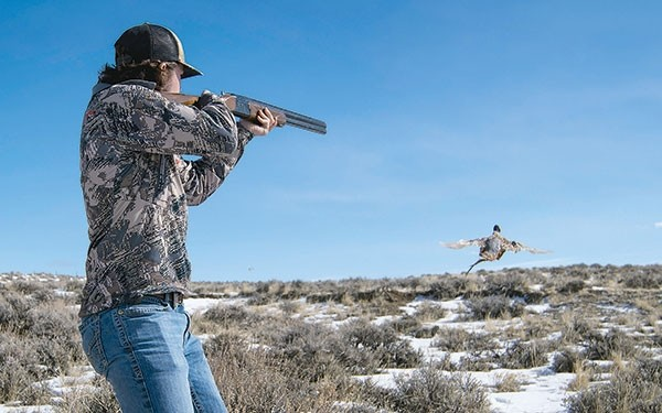 Brayden Polley, a 17-year-old hunter from Cody, harvests a rooster on his first shot of the day during the Big Horn Basin chapter of Pheasants Forever Bob Messier Youth Hunt on Saturday. Polley has attended the event for three years.