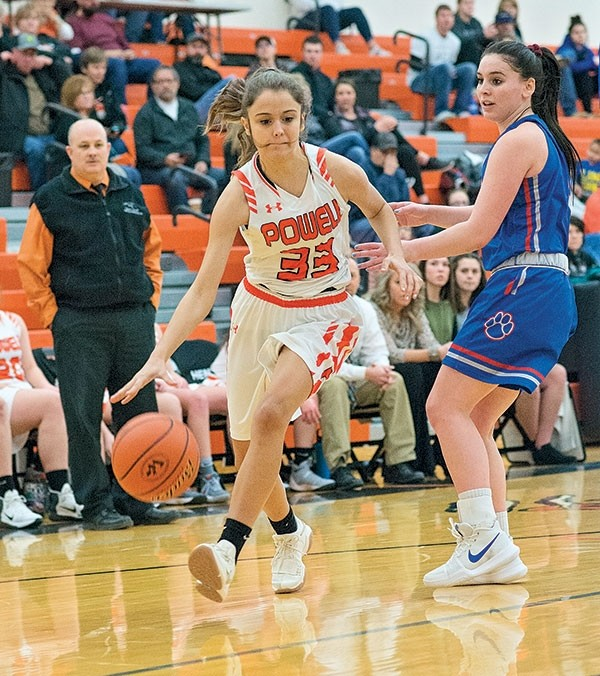 Powell High School junior Brea Terry dribbles into the key during a home game against Douglas on Saturday.
