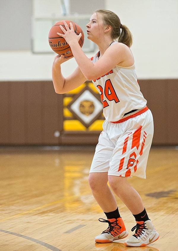 Powell High School sophomore Michele Wagner shoots a 3-pointer in a game against Burlington at the Big Horn Basin Classic in Cowley on Friday. Wagner made a total of four 3-point baskets.