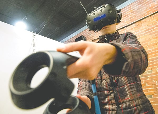 Breckin Streeter, a student at Powell Middle School, plays a virtual reality game at Valley Virtual on a special activities day in downtown Powell.