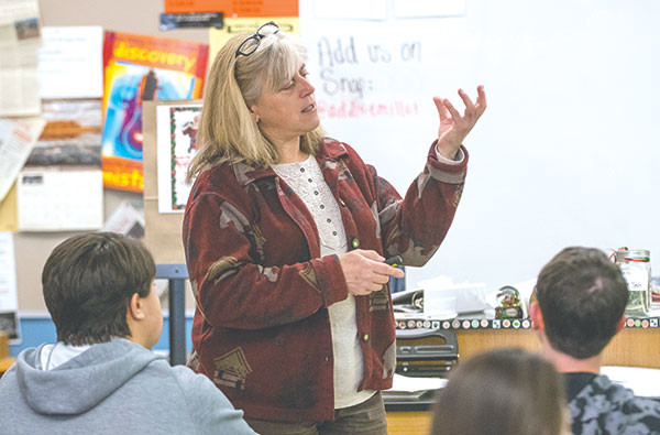 Wendy Smith, a science teacher at Powell High School, teaches her environmental science class Tuesday after taking her students on one of their several field trips.