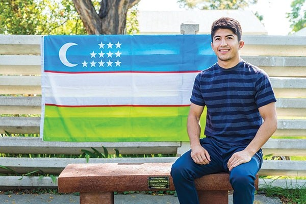 NWC Trappers wrestler Nodir Safarov is pictured here with the flag of his native Uzbekistan. Safarov opened his 2017-2018 wrestling season in a big way, winning the 125-pound elite class title at last weekend's Cowboy Open in Laramie. The Trappers finished eighth out of 20 teams in the event.