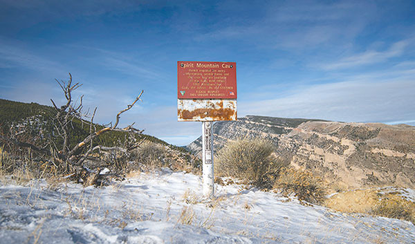 A simple sign marks the beginning of the trail at a small parking lot near the entrance to Spirit Mountain Cave. After a rough start to the trail, it evens out for an easy hike until a steep dropoff just before arriving at the entrance to the cave. Tribune photo by Mark Davis