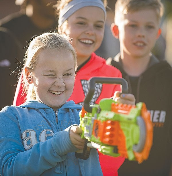 Brenna Henderson, 10, takes part in a target game during Thursday's Harvest Festival at Westside Elementary School. Enrollment within the Powell school system is up slightly this year, thanks in large part to a higher number of students at the high and middle schools.
