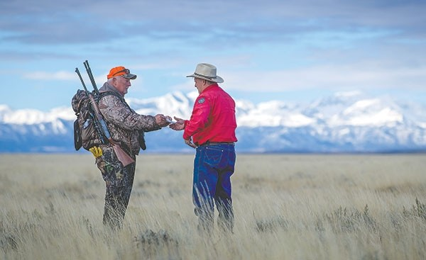 Scott Werbelow, game warden supervisor for the Game and Fish Department's Cody Region, checks a hunter from out of state while he looks for an antelope to harvest on Tuesday.