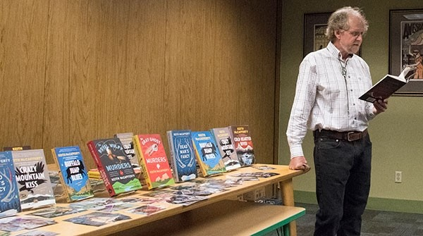 Author Keith McCafferty reads an excerpt from his latest novel, 'Cold Hearted River,' on Friday at the Powell Branch Library.