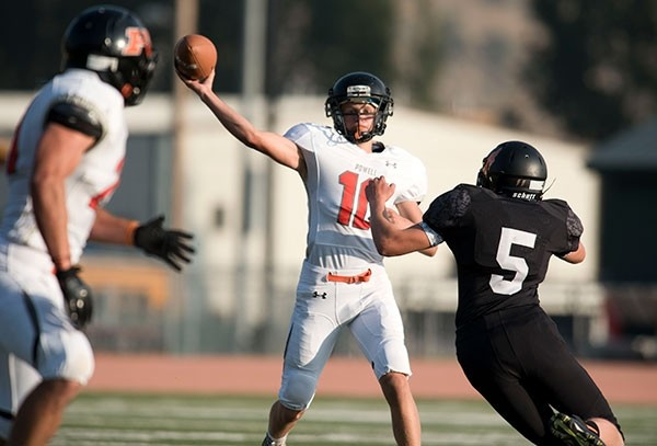 Powell High School junior Kaelan Groves passes the ball during Friday's game against the Jackson Broncs.