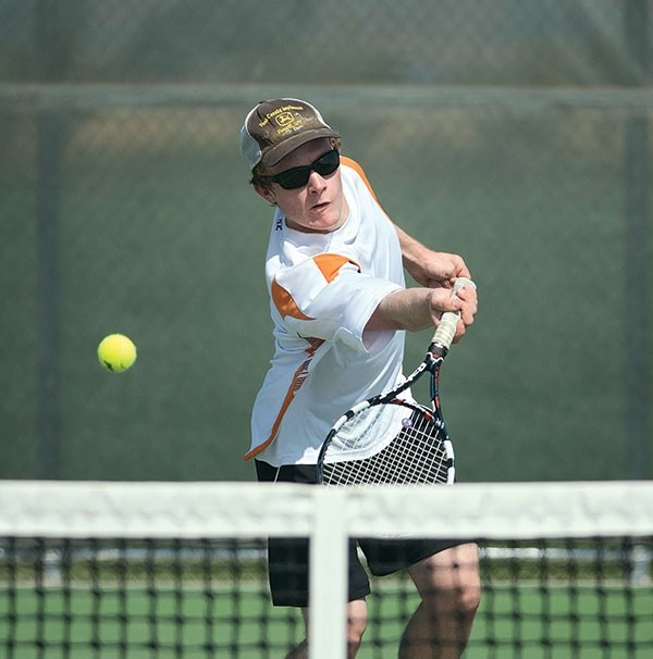 Rhett Pimental returns a serve against a Kelly Walsh opponent Saturday in his No. 2 singles match at Powell High School. Pimental won the match 6-3, 6-0.