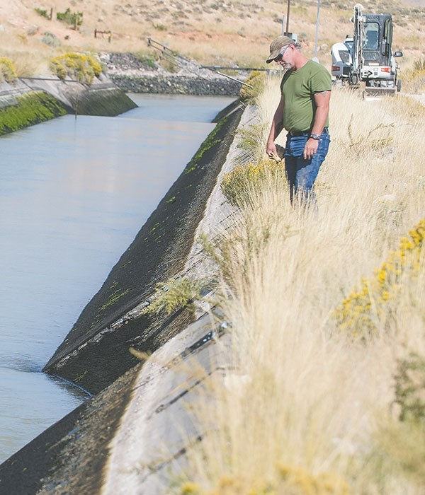 Randy Watts, manager of the Heart Mountain Irrigation District, inspects a leak to the Rattlesnake liner outside Cody, prior to fully draining the canal for emergency patch work. The team hopes to have the patch finished in three to four days, depending on weather.