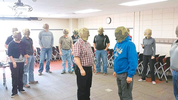 Principals and other administrators in Park County School District No. 1 underwent ALICE training last month, which stands for Alert, Lockdown, Inform, Counter, Evacuate. Participants wore masks to protect them from the air soft guns used during live training scenarios, adding a real-life feeling and atmosphere, said Jason Pellegrino, school resource officer with the Powell Police Department. 'It adds an element of healthy fear to bring the training home,' he said.