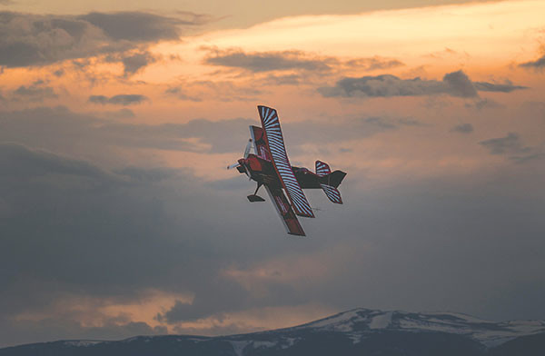 Fennell flies his biplane shortly before retiring it in favor of a new, stronger plane that he hopes will take him from the advanced class up to the unlimited class — which would place him among the top 50 pilots in the world in competitive aerobatics.