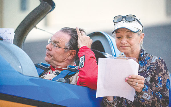 Gail Fennell critiques her husband's performance on a bad day. Gail has trained to be a judge for competitive aerobatics.