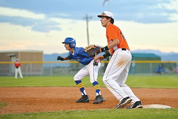 Powell Pioneers first baseman Luke Washington works to keep a member of the Cody Cubs squad close to the bag in a game last month. The Pioneers played in a wood bat tournament in Billings last weekend, winning one of out of five games.