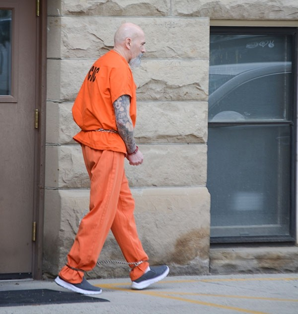 John Marquez walks to a waiting Park County Sheriff's Office vehicle outside the Park County Courthouse Tuesday afternoon after pleading guilty to second-degree murder and receiving a 25- to 35-year prison sentence.