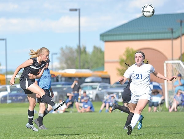PHS senior Kayla Atkinson kicks the ball up the field during the state tournament play-in game in Worland on Friday against Douglas. Atkinson scored two of the Lady Panthers' three goals in the 3-1 victory over the Lady Bearcats.