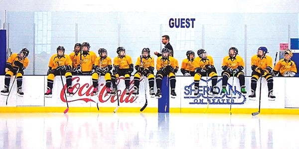 The Park County Ice Cat hockey team takes a little break during the Wyoming Amateur Hockey League Peewee B team state championships, which were held Feb. 24-26 in Sheridan.