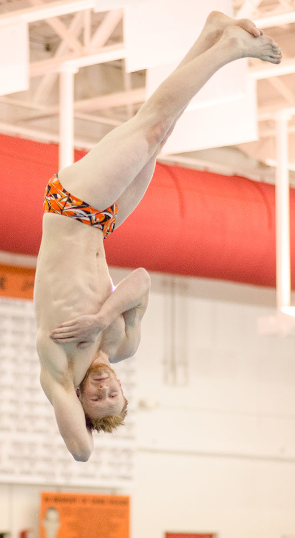 PHS senior Nate MaGill completes the fifth round dive during the home dual against Cody on Jan. 31. At conference over the weekend in Riverton, MaGill dove for a score of 418.95 which earned him the third place slot on Powell's Hall of Fame board and second place at conference in the 1 meter dives.