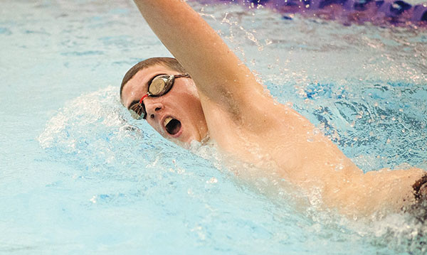 PHS swimmer Trenton Wilson competes in the 200 free relay during a home dual against Cody on Jan. 31. At conference, Wilson and teammates Dillinger Wilkerson, Chris Lopez and Joe Rogers swam to a fifth place finish in 1:44.07.