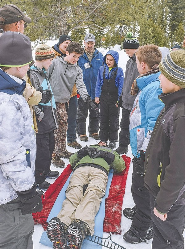 Boy Scouts from Lovell, Cody and Powell underwent winter survival and first aid training at Camp Buffalo Bill Saturday. A stretcher for the 'victim' must be fashioned PDQ from whatever material can be found, including blankets, a sleeping bag or, if handy, a rake.