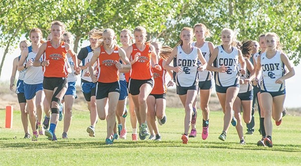 The Lady Panthers break out of the starting gate, along with the field of Cody, Lovell and Rocky Mountain runners, at Monday's Rocky Mountain Invite.