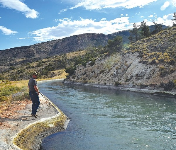 Randy Watts, Heart Mountain Irrigation District manager, takes a gander at the canal liner just downstream of the Rattlesnake tunnel. The liner must be repaired or more failures are likely, according to an Engineering Associates study commissioned by the Wyoming Water Development Commission.
