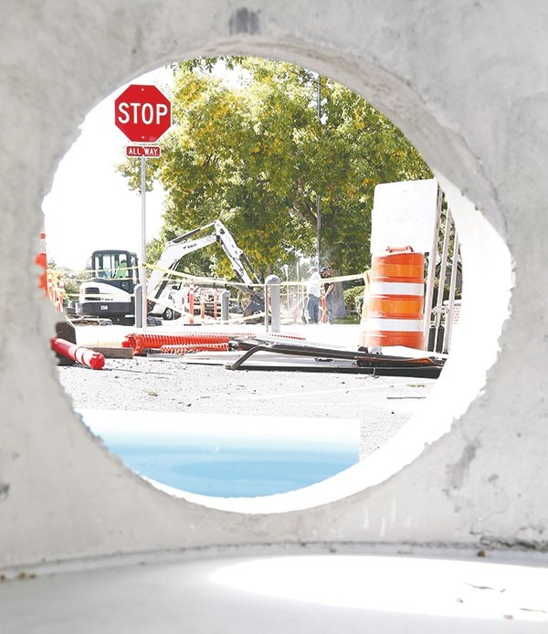 Construction work on Sixth Street in front of Northwest College is visible through a concrete culvert junction box last week. The project includes installing a drainage system and wheelchair-accessible curbs.