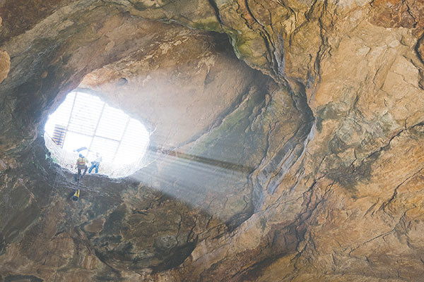 The descent into Natural Trap Cave requires a rappel of 85 feet. Climbing back out is slow going. Photo courtesy Dennis Davis